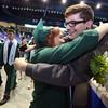 Billerica Memorial High School graduation. Alexandria Barrasso hugs her brother Daniel Barrasso, 16, as the graduates exit. (SUN/Julia Malakie)