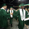 Billerica High graduation. Jonathan Sprague, left, shakes hands with Dan Katamani as graduates exit. (SUN/Julia Malakie)