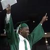 Isaac Sekanyo celebrates at Billerica High graduation. (SUN/Julia Malakie)