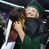 Billerica High graduation. Megan Crowley, right, hugs her volleyball coach, Katie Mara. (SUN/Julia Malakie)