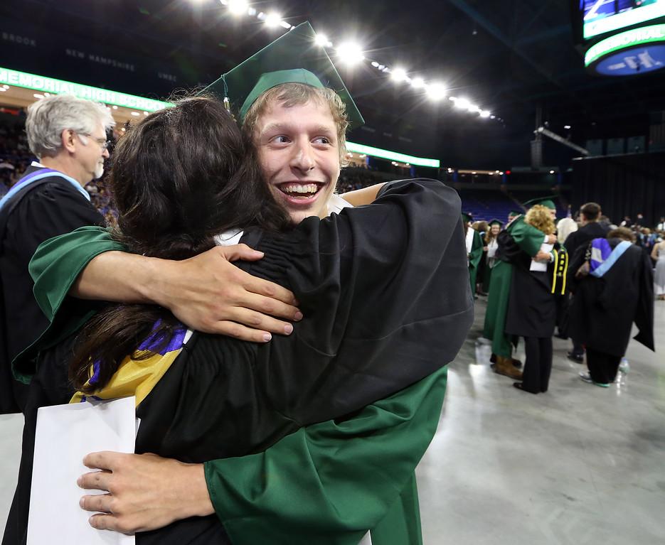 . Billerica High graduation. Garett Salzer hugs math teacher Nicole Viselli. (SUN/Julia Malakie)