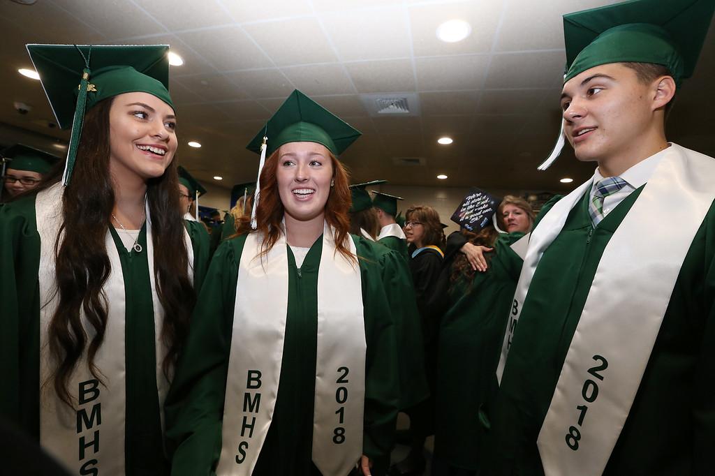 . Billerica High graduation. From left, Christie, Baglio, Kaitlyn Brouillette, and Aidan McCarthy. (SUN/Julia Malakie)