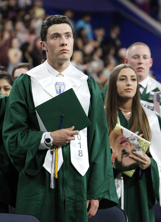 . Billerica High graduation. Matt Marini and Logan Peladeau stand for National Anthem. (SUN/Julia Malakie)