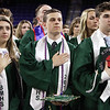 Billerica High graduation. From left, Alannah Biancuzzo, Nicholas Benjamin and Shawn Belden, during National Anthem. (SUN/Julia Malakie)