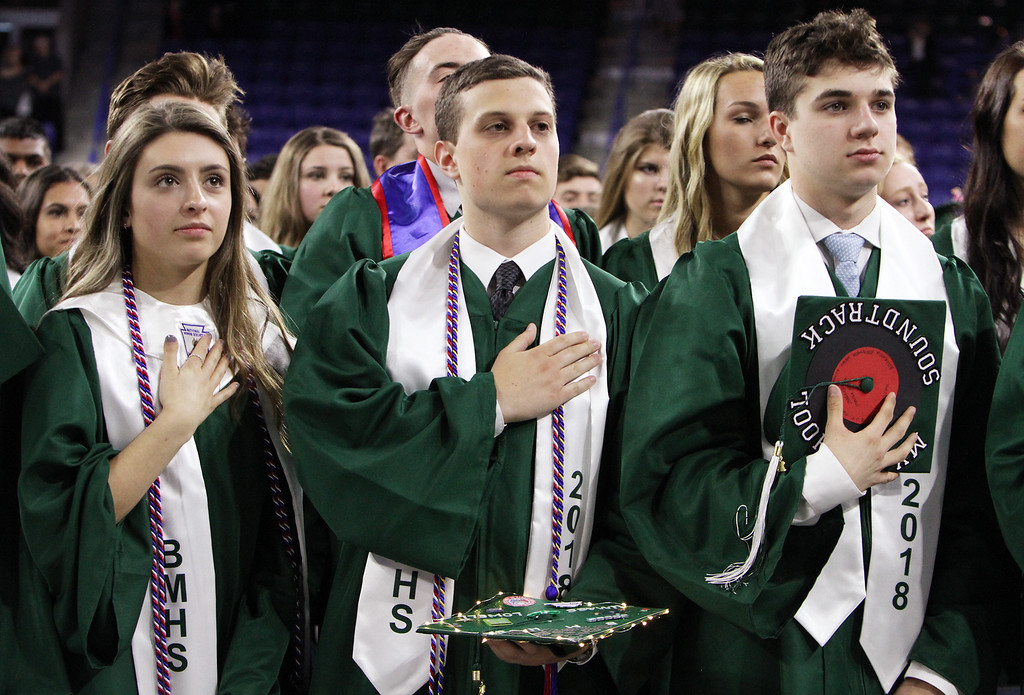 . Billerica High graduation. From left, Alannah Biancuzzo, Nicholas Benjamin and Shawn Belden, during National Anthem. (SUN/Julia Malakie)