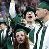 Billerica High graduation. Jillian Carbone, front, and Joseph Chasse [accent over E], rear, look to audience as graduates march in. SUN/Julia Malakie)