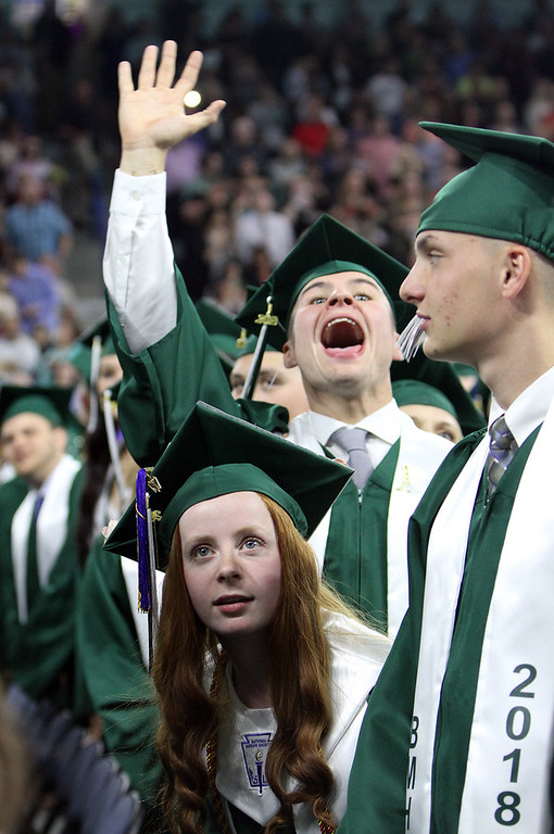 . Billerica High graduation. Jillian Carbone, front, and Joseph Chasse [accent over E], rear, look to audience as graduates march in. SUN/Julia Malakie)