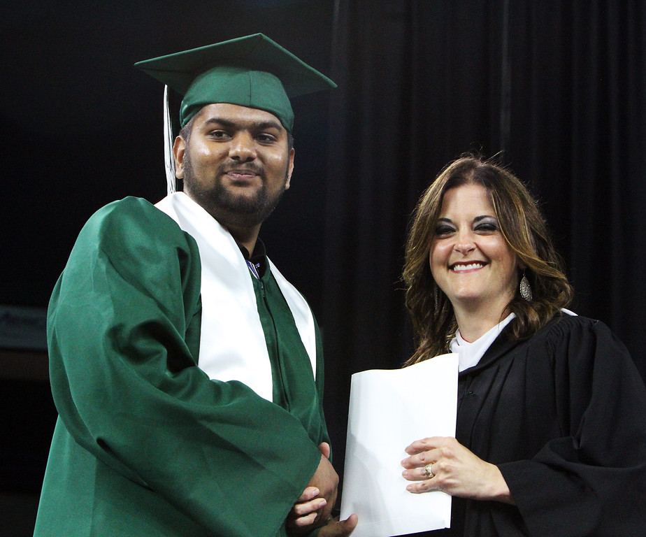 . Billerica High graduation. Arth Patel receives diploma from School Committee chair Katie Mahoney. (SUN/Julia Malakie)