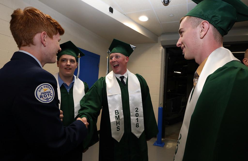 . Billerica High graduation. From left, freshman R.J. Fieler, Christopher Abrahamson, Dan Smith and Matthew Black. (SUN/Julia Malakie)