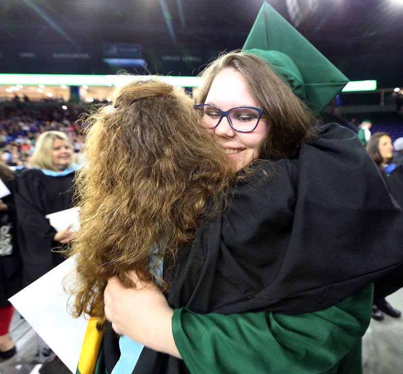 . Billerica High graduation. Kaylee Canada hugs former 4th grade teacher Vickie Aucoin. (SUN/Julia Malakie)
