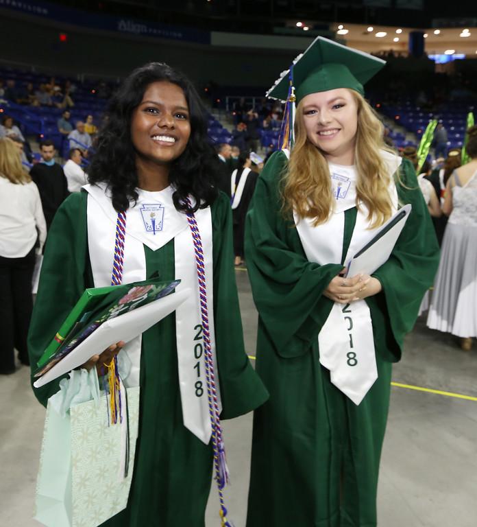 . Billerica High graduation. Madhu Sekar, left, and Leah Soto with their diplomas. (SUN/Julia Malakie)