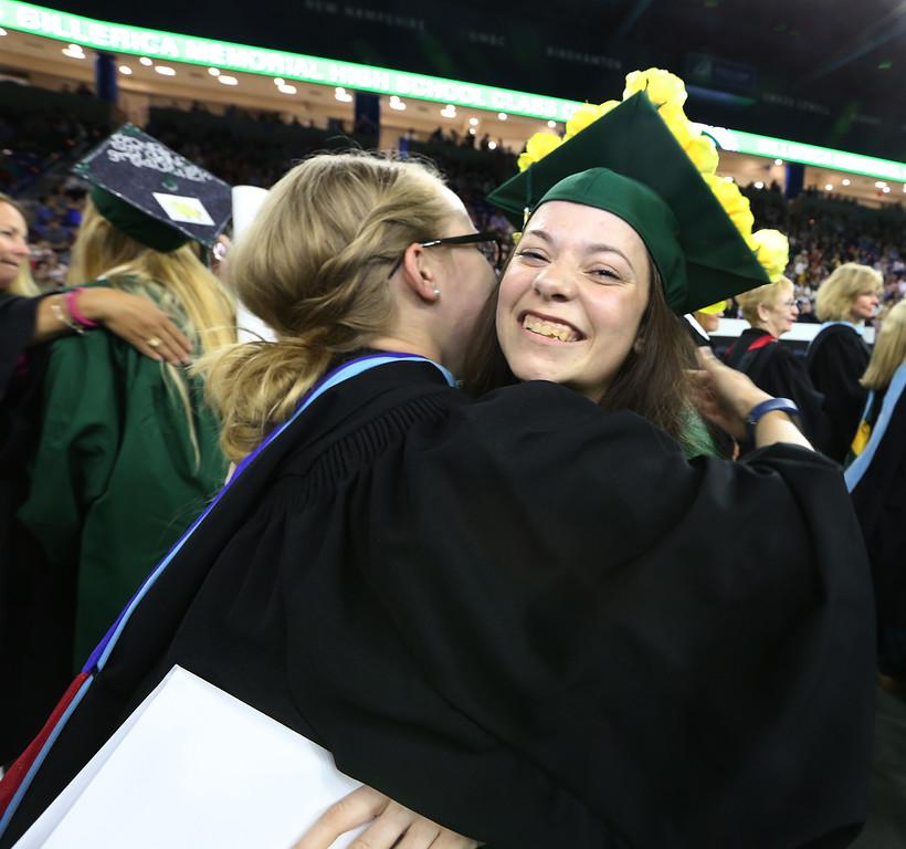 . Billerica High graduation. High school chemistry teacher Megan Shukri hugs Shannon Gauthier. (SUN/Julia Malakie)