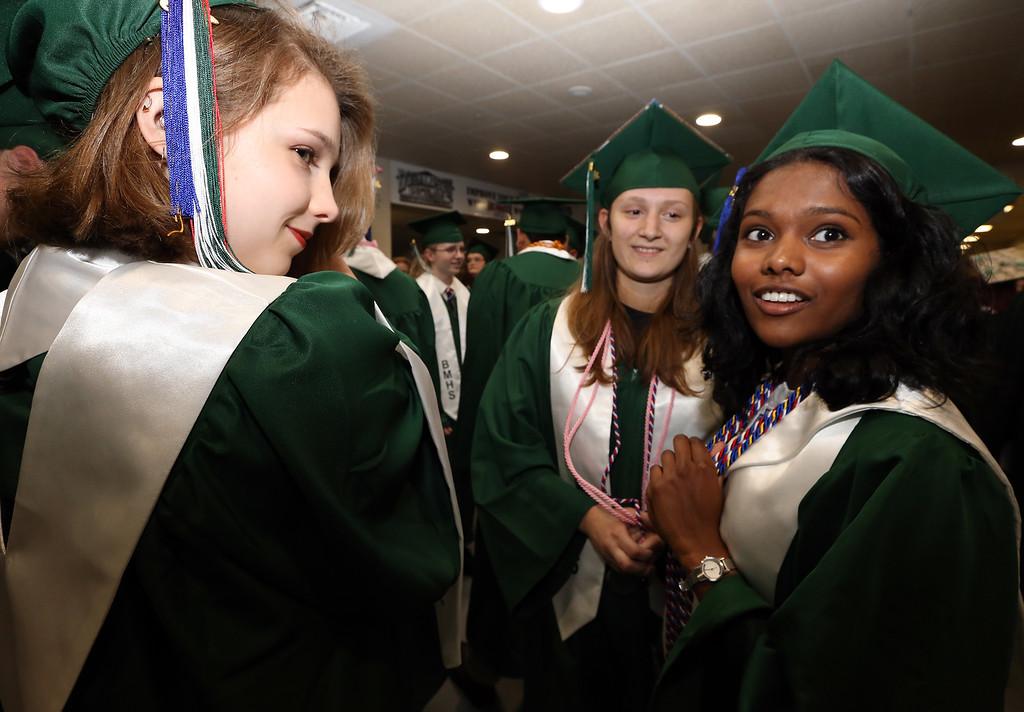 . Billerica High graduation. From left, Amanda Malnati, Emma Rugg and Madhu Sekar, before ceremony. (SUN/Julia Malakie)