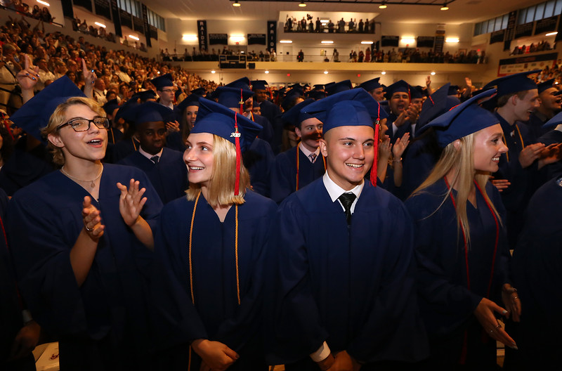 Central Catholic graduation at the high school in Lawrence. From left, Adele Lamere of Newton, N.H., Kesli Kruzel of Pelham, N.H., Thomas Krick of Methuen and Madelynn Kolifrath of Kensington, N.H. (SUN/Julia Malakie)