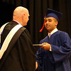 Central Catholic graduation at the high school in Lawrence. Davonn Smith of Lowell receives diploma from president Christopher Sullivan. (SUN/Julia Malakie)