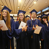 Central Catholic graduation. From left, Daria Bakhtiari of Wilmington, Lindsay August of Groveland, Nicholas Aswad of Dracut, and Grogan Ardizzoni of Hampton, N.H. (SUN/Julia Malakie)