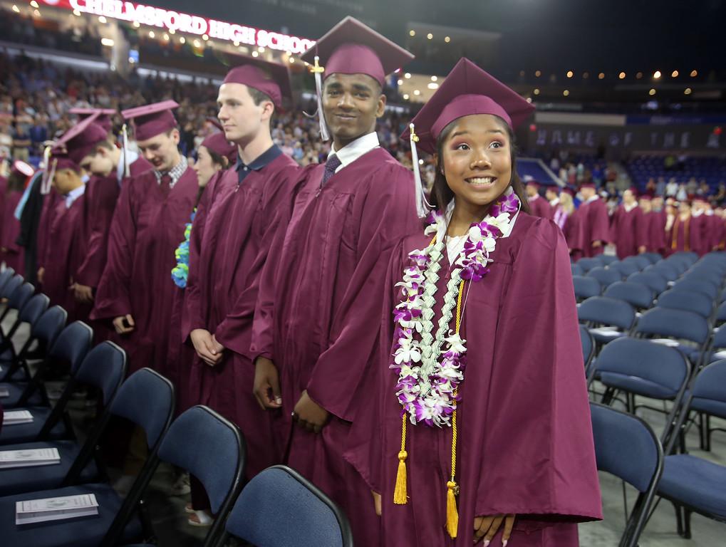 . Tiana Am, right, at Chelmsford High School graduation. (SUN/Julia Malakie)