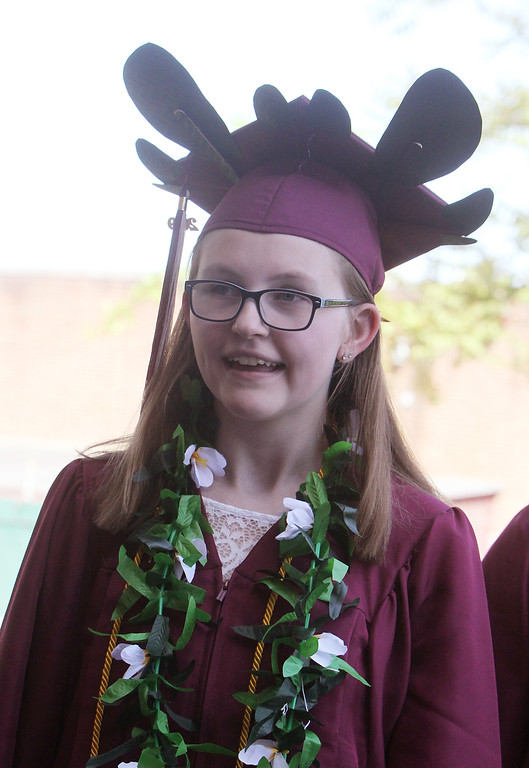 ". Chelmsford High School graduation. Maura Sweeney in line to enter, wearing a cap based on ""How to Train Your Dragon.\"" (SUN/Julia Malakie)"