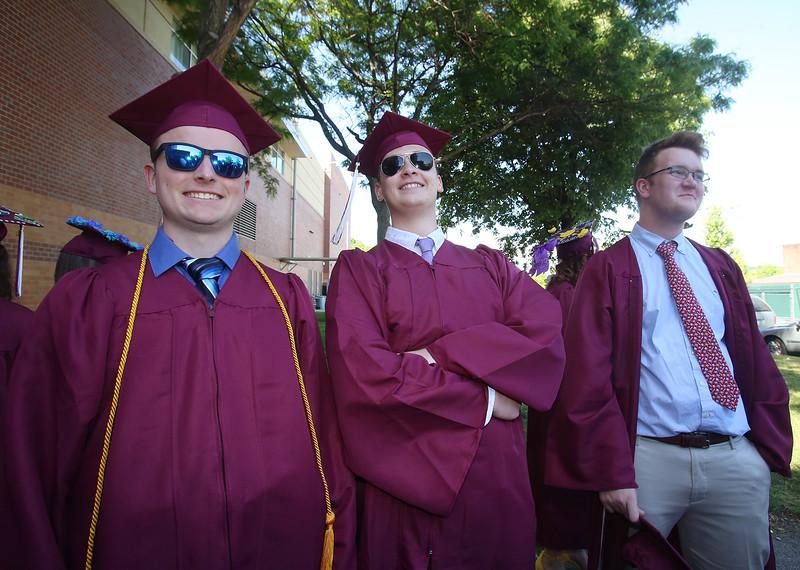 Chelmsford High School graduation. From left, Brendan Riley, Seth Parisi and Andrew Vinoski. (SUN/Julia Malakie)