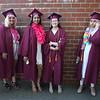 From left, McKenna Moore, Varshini Mohankumar, Lannae Miu and Nimrah Mir, in line to enter Chelmsford High School graduation. (SUN/Julia Malakie)