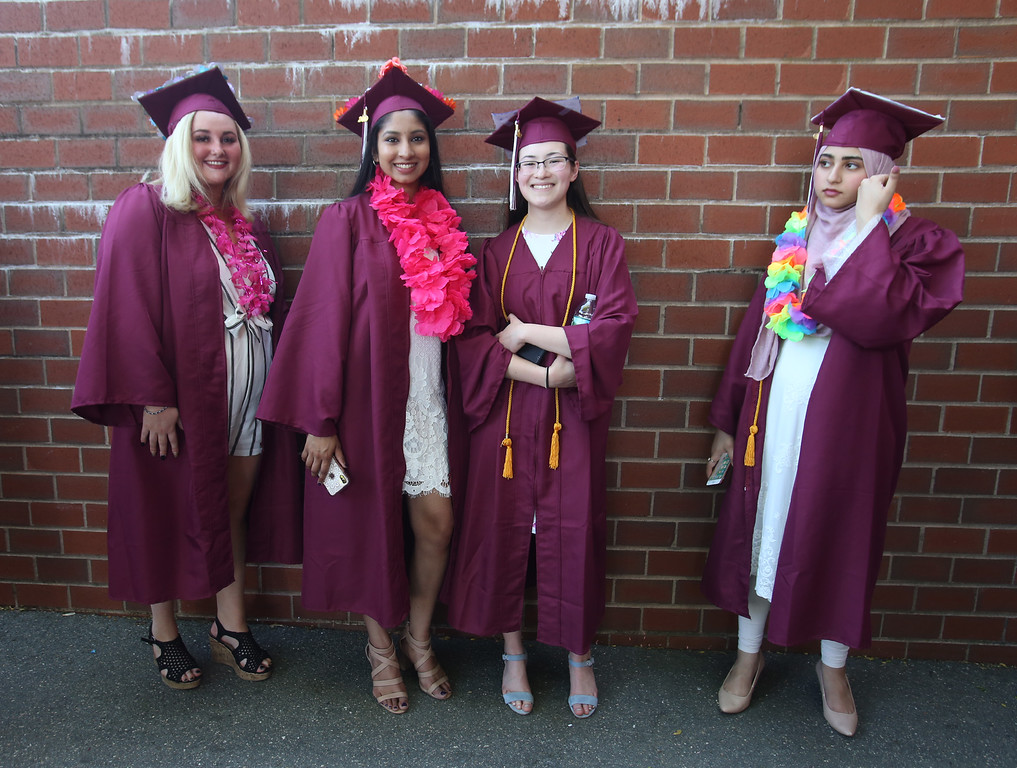 . From left, McKenna Moore, Varshini Mohankumar, Lannae Miu and Nimrah Mir, in line to enter Chelmsford High School graduation. (SUN/Julia Malakie)