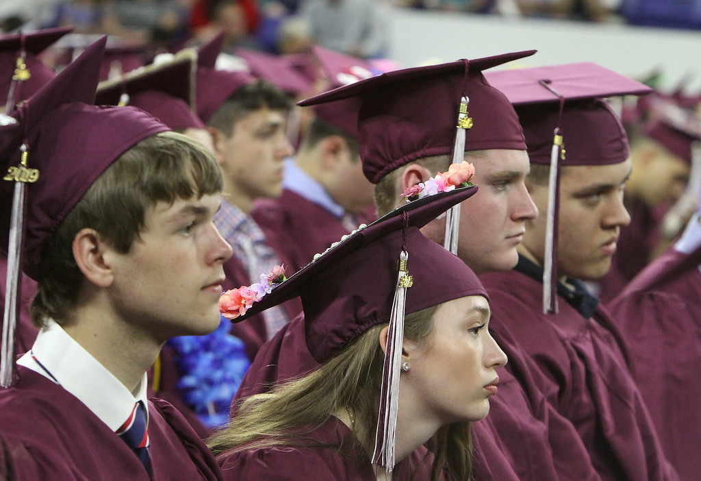 . Chelmsford High School graduation. From left, Christopher Volak, Ariana Turco, Aidan Trainor and Bryan Tait. (SUN/Julia Malakie)