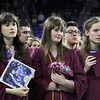 From left, Lovinia Collins, and twins Lora Coggins and Daniel Coggins, during National Anthem at Chelmsford High School graduation. (SUN/Julia Malakie)