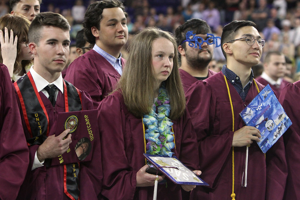 . From left, Cade Chalmers, Cathleen Cassels, and Caden Casiello, during National Anthem at Chelmsford High School graduation. (SUN/Julia Malakie)