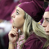 Alyssa Regan watches the big screen above at Chelmsford High graduation. (SUN/Julia Malakie)