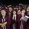 Chelmsford High School graduation. Just before turning their tassels, graduates are invited to stand where they can see the Jumbotron to watch a suprise music video about the class. From left front, Hoi Wong, Caroline Parlee, Isabella Caputo-Starkweather, Taylor Priore, and Darren Persad. (SUN/Julia Malakie)