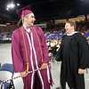 Chelmsford High School graduation. Class of 2016 president Landon Cass gets some good wishes from band director Matt Sexauer, just before being the last to receive his diploma. (SUN/Julia Malakie)