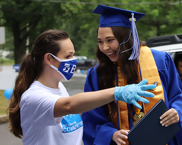 Nursing program graduate Megan Marnice gets instructions Butler Community College staff member Amanda Fleming during Saturday's drive-through graduation ceremony at the school's Butler campus. Seb Foltz/Butler Eagle 08/01/20