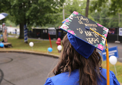 A BC3 graduate waits for pickup during drive-through ceremonies Saturday. Seb Foltz/Butler Eagle 08/01/20