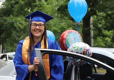 Cierra Gray steps out of her car to walk at Butler County Community College's drive-through graduation ceremony Saturday. Graduates and their families drove through campus with stops for video message commencement ceremonies before getting out of the car and walking in front of a limited amount of staff.  Seb Foltz Butler Eagle 08/01/20