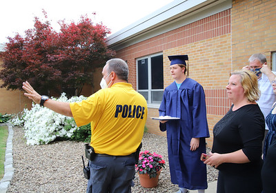 School police officer Pat Sarnese directs a student and his family into the courtyard at Knoch High School during graduation. Seb Foltz/Butler Eagle
