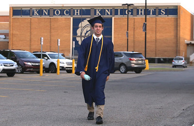 Holden Stallsmith walks up to the front of Knoch High School for graduation. Seb Foltz/Butler Eagle