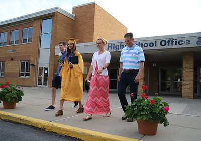 Megan Swantner walks out of Knoch High School with her brother Michael, father Mike and mother Amy after recievingn her diploma. Seb Foltz/Butler Eagle