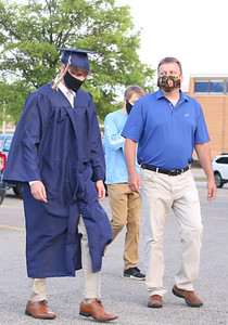 Joey Wojciechowski walks up to Knoch High School with his family to chech in for graduation. Seb Foltz/Butler Eagle