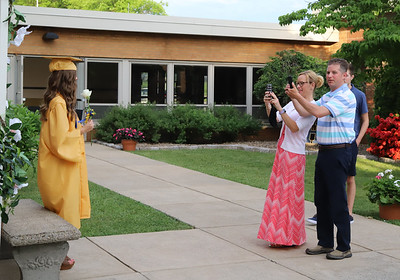 Amy and Mike Swantner take pictures of thier daughter Megan at Knoch graduation. Seb Foltz/Butler Eagle
