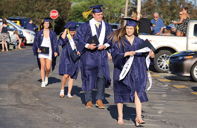 With social distancing guidlines, the Mars Area School District held graduation in the high school parking lot with families parked in every other spot. Students recieved their diploma, posed for pictures and then walked through the parking lot to cheers and congratulations. Seb Foltz/Butler Eagle 06/12/20