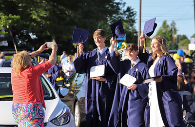 Triplets Austin(left), Grant and Reagan Lloyd pose while their mother Linnae Lloyd snaps a photo at Mars Area School District graduation Friday. Seb Foltz/Butler Eagle 061220