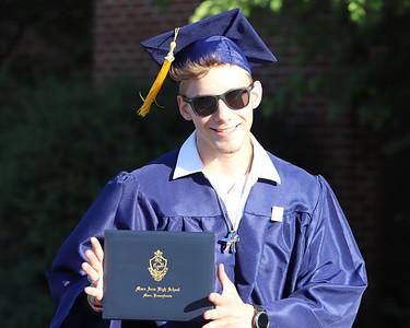 Dakota Boyle shows of his diploma at Mars' graduation Friday. Seb Foltz/Butler Eagle 06/12/20