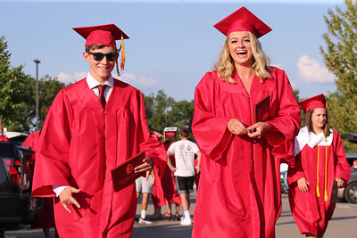 Brendan Haggerty and Meghan Grill walk the parking lot at North Catholic Highschool during graduation ceremonies Friday. Seb Foltz/Butler Eagle. 07/24/20