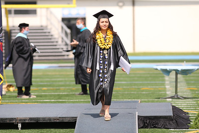 Kate Scanlan walks off stage after recieving her diploma Friday at Seneca Valley's graduation. Seb Foltz/Butler Eagle