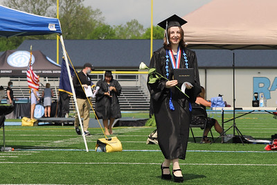 Seneca Valley senior Emily Nicole Richards walks away from the stage after recieving her diploma Friday. Seb Foltz/Butler Eagle