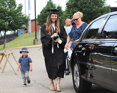 Madison Smith steps into a limo with family following graduation Friday at Seneca Valley. Seb Foltz/Butler Eagle