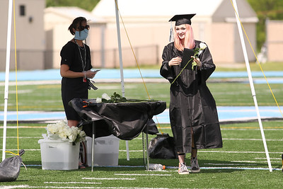 Seneca Valley Class of 2020 graduate Anne Schaar recieves a rose after walking for graduation Friday. Seb Foltz/Butler Eagle
