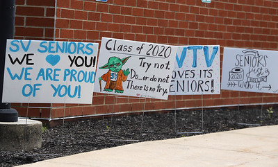 Congratulatory signs line the drive up to NexTier Stadium on Seneca Valley High School's campus. Graduates and their familes drove up to the stadium to drop off students to walk for ceremonies Thursday and Friday. Seb Foltz/Butler Eagle
