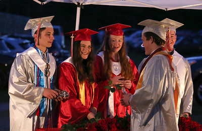 Class officers Nate Gill, Calla Martin, Julia Hart and Anthony Bede hand out roses anl congratulate graduates during  Slippery Rock High School graduation. Seb Foltz/Butler Eagle