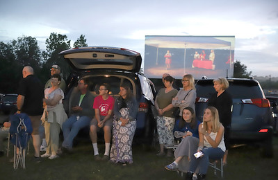 Friends and family watch Slippery Rock High School graduates walk during ceremonies at the Starlight Drive-In. Seb Foltz/Butler Eagle